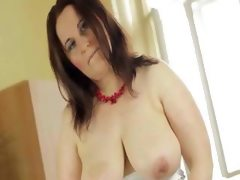 Busty mature pleasing hairy twat