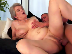 Granny is sucking a horny hard young..