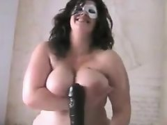 Masked bbw with her huge black dildo