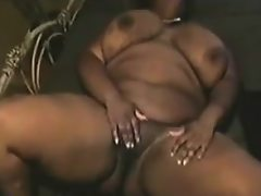 Large ebony woman masturbating