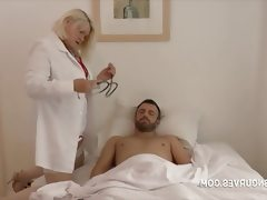 Old nurse looking after patient