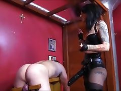 Cruel mistress fucks slave with a..