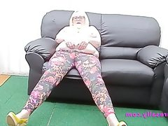 Sally barelegs on the couch
