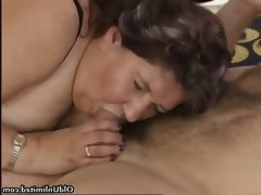 Nasty old slut sucks on an hard cock